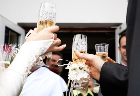 on the wedding. a bride and groom hands with champagne glasses