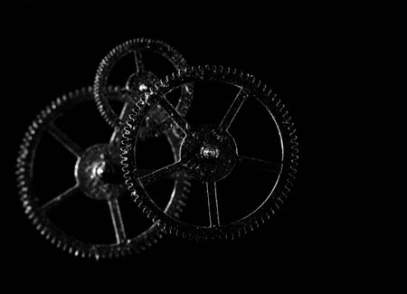 old cogwheel over black backgrounds photo