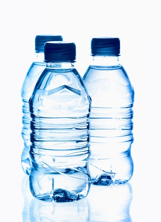 purified: purified spring mineral water in the bottles with reflection