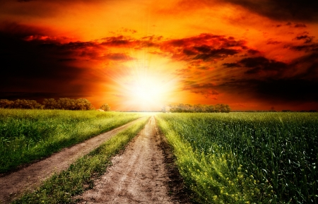 Dramatic sunset over the rural landscape photo