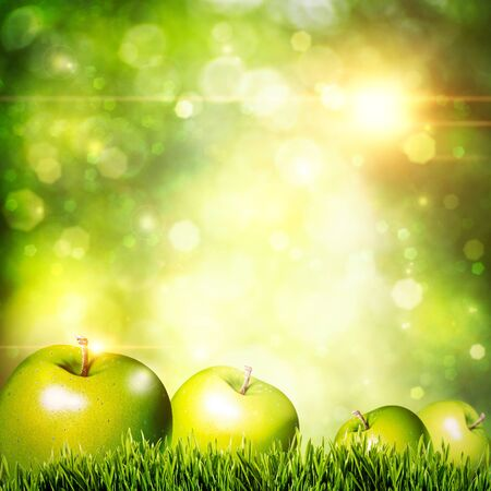 Fresh tasty apple on the grass. Abstract natural backgrounds photo