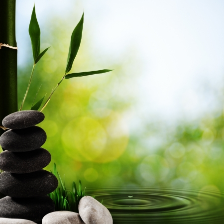 wellness environment: Abstract asian spa backgrounds with bamboo and pebble Stock Photo
