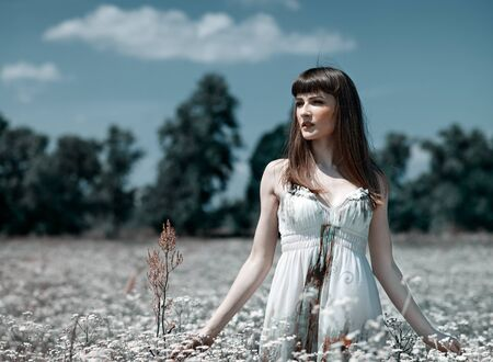On the meadow, abstract natural backgrounds with beauty young woman photo