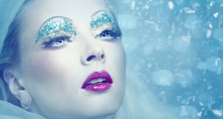 Lady Winter. Seasonal female portrait with snowflakes photo