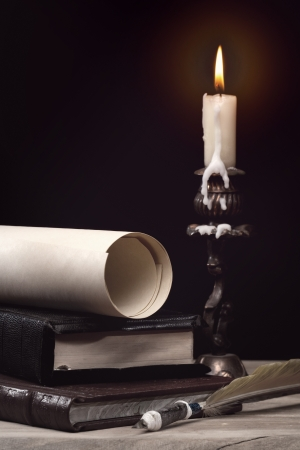 Art still life  with burning candle over old wooden desk Stock Photo - 17655894