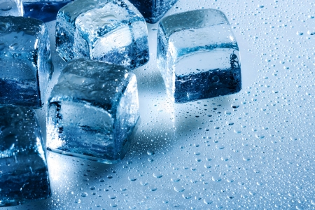 Ice cube and water drops on the wet background Stock Photo - 17655929