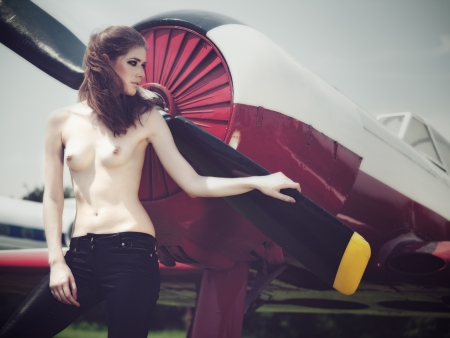 Retro female portrait with vintage jet as background