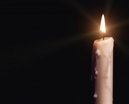 Burning candle over black. Is not isolated, just shot on black Imagens - 20443719