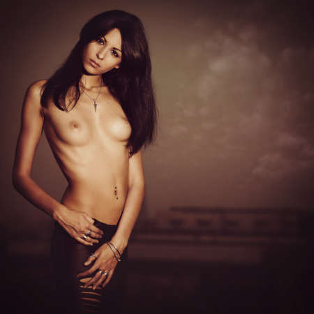 Beauty Stranger. Female portrait against grungy terrible backgrounds photo