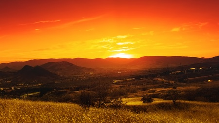 Dramatic sunset over valley. Natural seasonal landscape