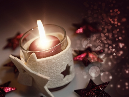 Christmas still life with candle and beauty bokeh photo