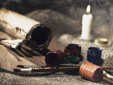 Grungy Art still life with paint and brushes photo
