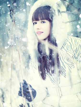 Through the winter forest, female portrait photo