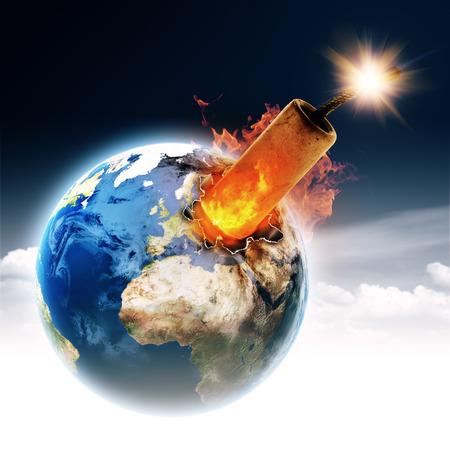 Do not make it a bomb! Earth globe with burning TNT block Stock Photo - 26204258