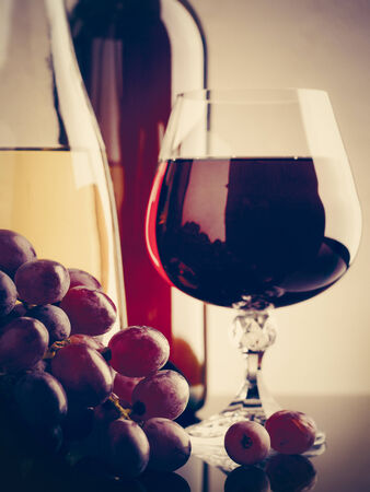 winy: Wine and grape. Winery still life on the glass with reflections