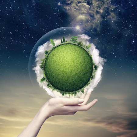 hands in the air: Green planet into the human hand, environmental backgrounds