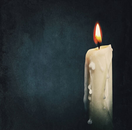 candles in dark: Burning candle over black. Is not isolated, just shot on black