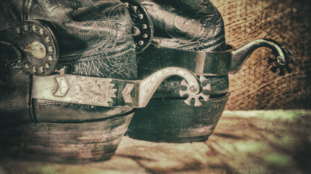 Abstract grungy western backgrounds with cowboy boots Stock Photo