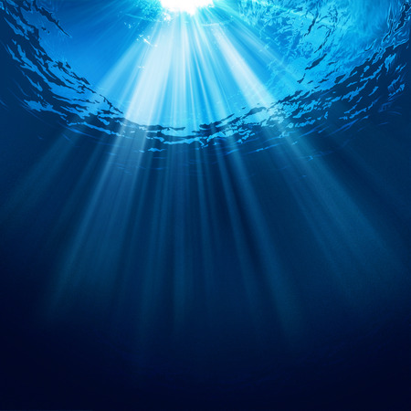 sun from underwater: Abstract underwater backgrounds with sun beam and water ripple