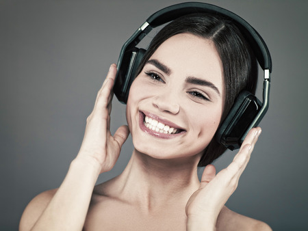 rec: Beauty young girl hearing music with headset, female portrait Stock Photo