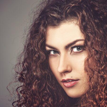 coloring lips: Fashionable female portrait. Vogue style brunette girl.