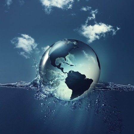 Save the planet. Earth globe on the water waves, abstract natural backgrounds