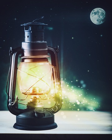 Moonlight lanterns: Wonderful night and vintage magic lantern on the window, abstract holidays background