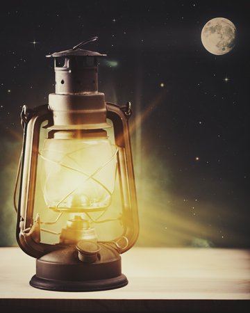 Moonlight lanterns: Wonderful night and vintage magic lantern on the window, abstract holidays background