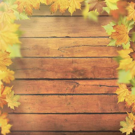 old backgrounds: Autumnal leaves over old wooden desk, seasonal backgrounds