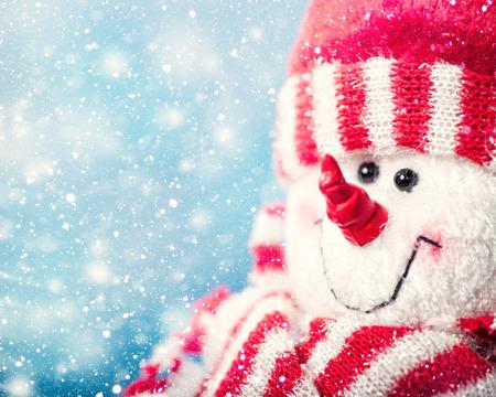 christmas backgrounds: Funny snowman portrait against snowfall, abstract christmas backgrounds