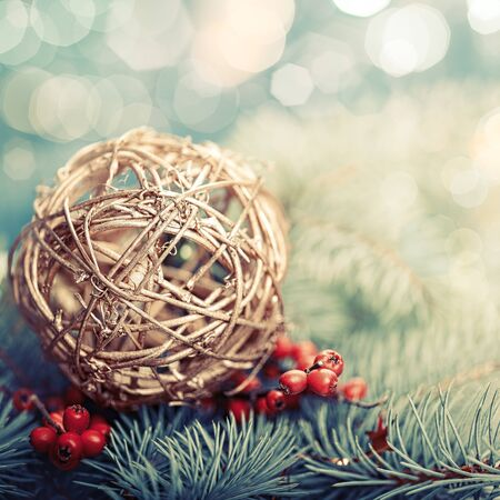 christmas fun: Golden ball. Abstract Xmas decorations over pine tree