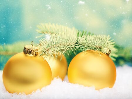 christmas blue: Golden balls. Abstract Xmas decorations over white snow