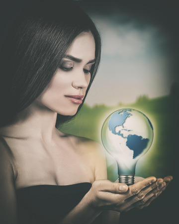 sustainable development: Eco female portrait. Sustainable development and renewable  power concept