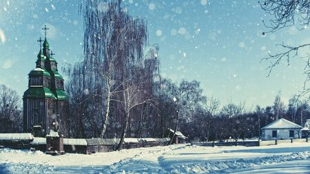 christmas church: Ukrainian village with old slavic gospal church and buildings, winter view