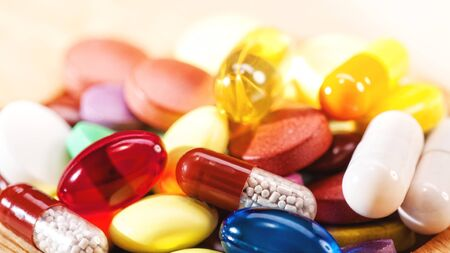 critical care: Abstract medical backgrounds with colorful pills for your design