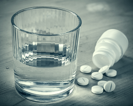 neuralgia: Depression. Abstract medical backgrounds with pills and glass of water over wooden desk Stock Photo