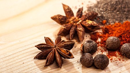 piquancy: Assorted spices over wooden desk, food backgrounds