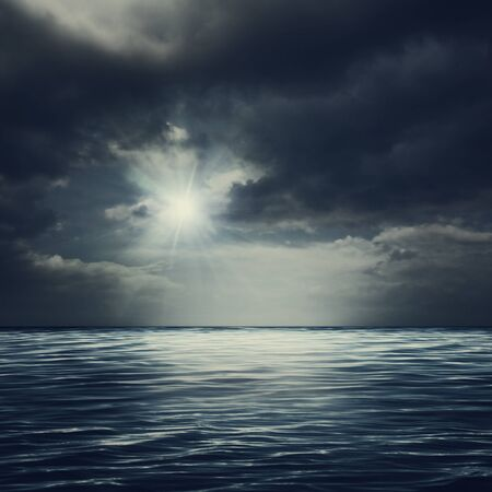 beneath the surface: Sea surface under stormy skies, abstract natural backgrounds Stock Photo
