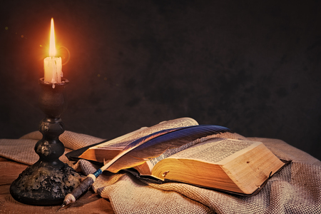 Old fashioned backgrounds with opened Holy Bible