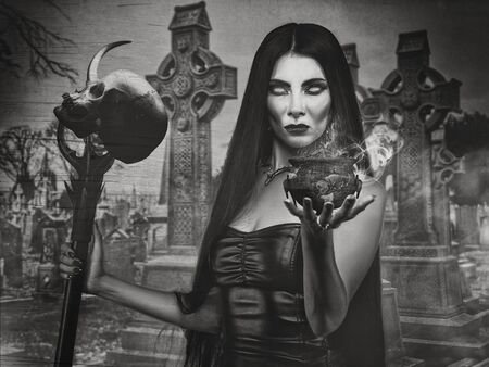 necromancer: Halloween backgrounds with witch woman and spooky cemetery Stock Photo