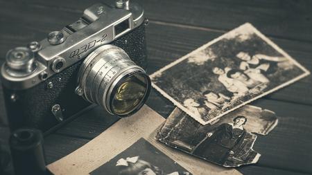 October 23, 2017, Kiev, Ukraine. Still life with retro soviet photo camera FED-2 and lens Industar over wooden desk