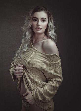Beautiful adult blonde posing at camera, female portrait Standard-Bild