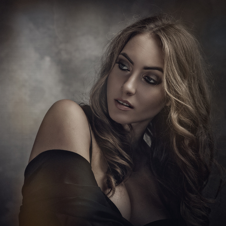 Vamp style blonde, Dramatic female portrait with faded colours