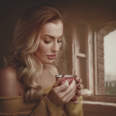 Early morning with scented coffee. Beauty female portrait with cup of drink