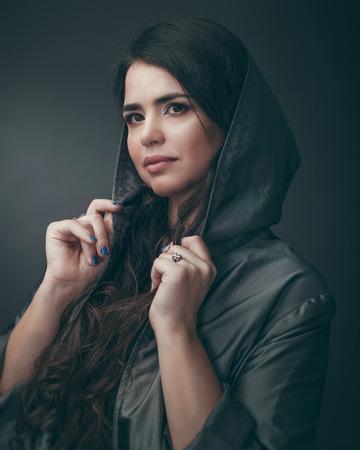 Beautiful plus size model posing at camera, dramatic female portrait Standard-Bild
