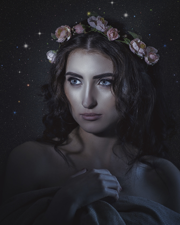 Fantastic Universe. Beautiful young woman in floral crown Standard-Bild