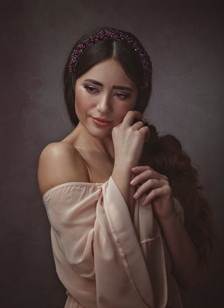 Beautiful young adult woman with charming beauty face. Retro style female portrait