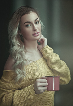 Happy morning. Female portrait, young adult woman with cup on coffee Standard-Bild