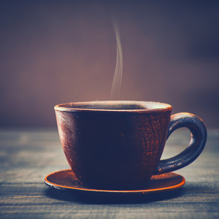 Morning coffee. Cup of flavor drink over old wooden desk