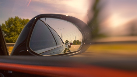 Looking through the mirror, street racers view, transportation backgrounds Standard-Bild - 107206056